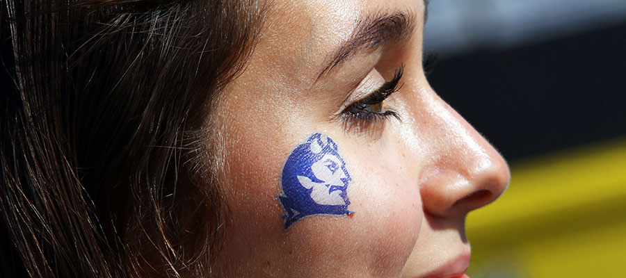Student with blue devil logo tattoo